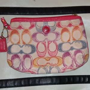 COACH Watercolor graphic wristlet pink trim